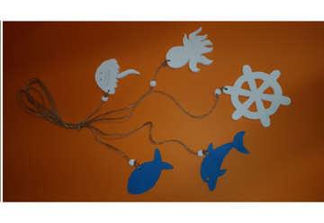 Immagine di Cordini ancora e soggetti marini in legno