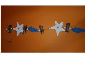 Immagine di Cordini stelle e cavallucci in legno