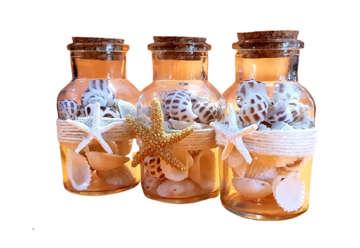 Immagine di Bottigliette in vetro con sabbia e decori marini 11cm