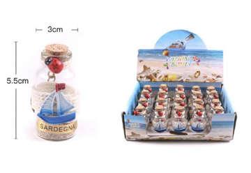 Immagine di Portachiave bottiglietta Sardegna sabbia e conch con barchetta